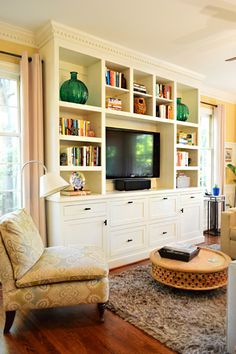 """See these built-ins? (They) hired a local handyman to build them to fit between those two windows and provide a ton of kid-friendly storage. So smart. I especially liked that they chose doors that are flush with the frame (it had a really clean look)."" - also like that they're not too deep, they just fit with the room!......House Crashing: Cozy & Full Of Character 