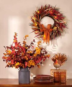 """This Natural Harvest Decor Collection features natural elements that work well for the fall season. The vibrantly colored Lighted Wreath (22"""" dia.) is made of n"""