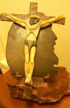 Body of Christ: Light & Dark Jades Cross: Petrified Wood Nails: Facetted Rubies Background: Translucent Rainbow Obsidian Light In The Dark, Gemstone Art, Greek Statue, Statue, Art Style, Artwork, Hand Carved, Stone Artwork, Sculpting