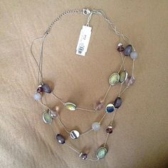 3 layered necklace NY&Co. three layered bead necklace. Never worn. New with tag. New York & Company Jewelry Necklaces