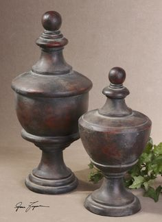 Uttermost Gracelyn Antique Finials. These decorative finials feature a heavily, antiqued dark mahogany finish with burgundy undertones. Sizes: Sm-8x15x8, Lg-9x20x9