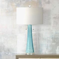 For the master bedroom, on sale now for $69.95 each at lampsplus.com  Possini Euro Miriam Blue Glass Table Lamp