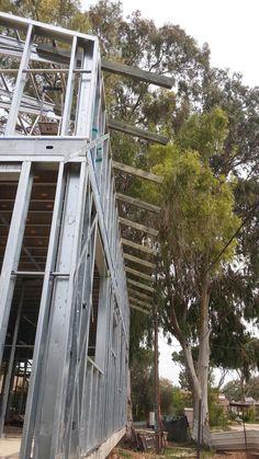 בניית בית לב בגת: חיבור עץ לקונסטרוקצית הגג