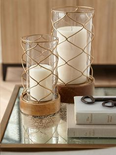 These Nate Berkus hurricanes are a simple way to infuse gold into any decor.
