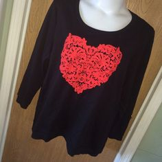 """Black top with red crochet heart Black long sleeve top with red crocheted heart on the front. I don't think it's ever been worn. Size 2x. 60% cotton 40% polyester. 28"""" from armpit to armpit 22"""" from armpit to hem. No brand  Tops Tees - Long Sleeve"""