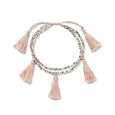 The White Company | Brass Bead Tassel Bracelet - Pale Pink. This pretty bracelet is the perfect finishing touch to our bohemian tops, cover-ups and carefree linen dresses this Summer. Shopping from the UK? http://www.thewhitecompany.com/Brass-Beaded-Tassel-Bracelet/p/TSCBP?swatch=Pale+Pink