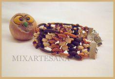 082 En cola de ratón colores tierra: marrón, arena y cobre, elaborada con técnica de macramé. Precio: 5 euros.