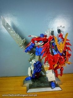 """In a nutshell the Transformers GO Optimus Prime can best be described as a beautiful mess. It is something you keep in a glass case in the corner of a room that bored party guests spy and have to ask """"What the f*$k is that?"""" #Transformers #TransformersGo #OptimusPrme #OptimusExPrime"""