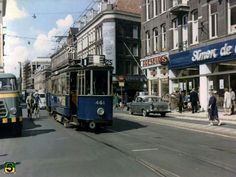 1963. Tramlijn 25 riding through the Ferdinand Bolstraat in Amsterdam. From right to left: supermarket Simon de Wit, shoe store Presburg and electronics store Duyvene & Remmers. Photo Serc. #amsterdam #1963 #FerdinandBolstraat
