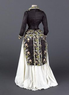 Black striped redingote over white skirt, From the Musee Galliera - Fripperies and Fobs 1870s Fashion, Edwardian Fashion, Vintage Fashion, Steampunk Fashion, Gothic Fashion, Vintage Outfits, Vintage Gowns, Style Édouardien, Looks Style