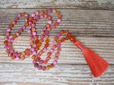 This sunset-inspired Fire Agate Japa Mala has a marvelously cheerful combination of 108 8mm beads, as well as one 12mm guru bead. It features the following gemstones:  8mm Faceted Caribbean Fire Agate 8mm Red Botswana Agate 8mm Tropical Fire Agate 12mm Faceted Carnelian Guru Bead