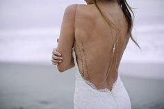 Backless wedding dress with side tattoo @myweddingdotcom