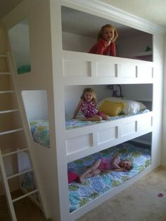 My hubby made this awesome triple bunk for our girls.  They love it!!  Now each girl has her own space.