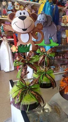 Safari centerpiece Baby shower centerpiece by BabyPartyBoutique Offer is for 1 beautiful baby shower animals themes centerpieces, can be made . Jungle Theme Birthday, Safari Theme Party, Party Themes, Themed Parties, Boy Baby Shower Themes, Baby Shower Cards, Baby Boy Shower, Safari Centerpieces, Baby Shower Table Centerpieces