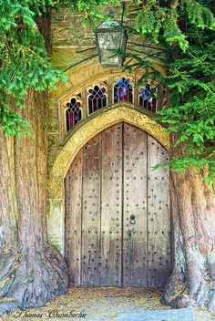 This back door at the St. James Church in the village of Stow-in-the-Wold in England is thought to be the inspiration for the Moria door in Tolkein's Lord of the Rings series. He was known to have passed through this area prior to writing The Lord of the Rings. The door is flanked by yew trees, often planted in church lots due to a spiritual significance