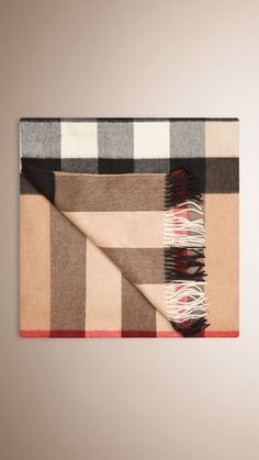 The iconic Burberry 'Nova' Check Cashmere Blanket. Which is consistently is on the back seat of the Range Rover.  They 'suit' each other.  Beautifully.