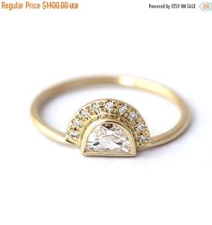 Half moon diamond engagement ring in 18k solid gold. Unique and refine ring. Due to the diamond setting, the ring can be comfortably stack with a wedding