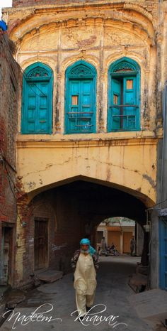 Passing under an arch in a street in Chiniot, Pakistan. Chiniot is located on the banks of the river Chenab. It is known throughout Pakistan for its intricate wooden furniture and architecture.