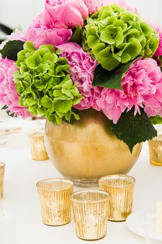 Mixed Pink peony and green hydrangea in gold globes, surrounded by gold votives