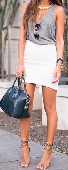 Chic. Tank, mini skirt with longer back & cute as hell heels!