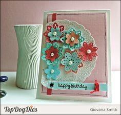 We love how this birthday card turned out! This designer was versatile and used our Top Dog Dies Pretty Petals Die Set, Cherish Doilies & Tags Die Set; and our Camera Finishers Die Set to add that extra flare.