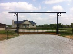 Wood and Ornamental Iron Double Swing Gate built by Titan Fence & Supply Driveway Entrance, Entrance Gates, Double Swing, Custom Gates, Fence, Building, Wood, Design, Entrance Doors