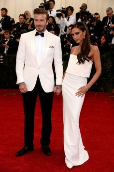 He looks amazing, i don't think Victoria's dress looks good on her