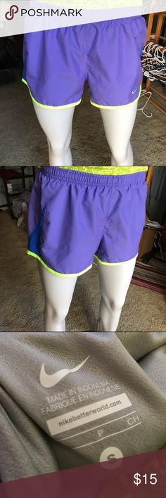 Nike violet and green athletic shorts Blue purple shorts with chartreuse trim. Perfect for exercising or any workout! in excellent condition. Lined. Nike Shorts