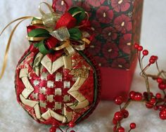 Each fabric Christmas ornament is one-of-a-kind and hand made by me with dozens of squares of designer cotton fabric individually folded and