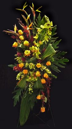 Tropical flowers in a standing sympathy tribute. Designed by Alice Woodside Lynch.