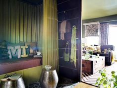 New Yorkers Sarah Raskin and John Kerl needed to turn a portion of their small apartment living room into a separate bedroom-like area. Thankfully designer Brian Patrick Flynn had a plan.