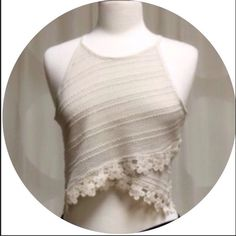 🎉FLASH SALE🎉✨5⭐️ RATED LACE TRIMMED CROP TOP-SM✨ Stunning lace trimmed cropped top in Beige. Perfect for Summer with your favorite shorts, jeans or skirts. Excellent quality. Regular fit.  Runs true to size. 76% Cotton; 21% Polyester; 3% Spandex. Made in the USA 🇺🇸.  AVAILABLE IN Small and Large. THIS LISTING IS FOR A SMALL, AND AVAILABLE TO PURCHASE. April Spirit Tops Crop Tops