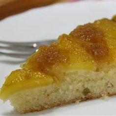 Fresh peach halves in a nutmeg-spiced sauce top this buttery upside down cake. Serve with whipped cream.