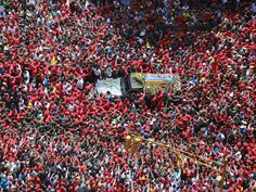 People surround the flag-draped casket of Venezuelan President Hugo Chavez during a procession on March 6 in Caracas. The procession marched from the hospital where he died to a military academy where his body will lie in state. Chavez, 58, died on March 4 shortly after returning from Cuba where he was being treated for cancer.