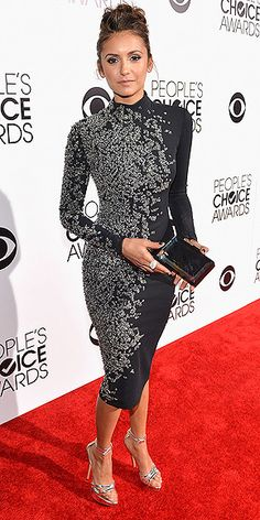 And you thought vampires only sparkled in Twilight! Vampire Diaries star Nina Dobrev proves that wrong in a glittery full-coverage Jenny Packham turtleneck dress and a truly intricate updo. http://www.peoplestylewatch.com/people/stylewatch/package/gallery/0,,20768378_20773354,00.html#30079862
