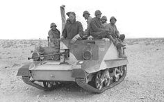 A British Universal Carrier transports Italian POWs to the rear. North Africa WWII - pin by Paolo Marzioli