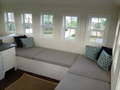 Customer Photo: Custom Bench Cushions in Sunbrella Heritage Ash with Throw Pillows in Sunbrella Navy
