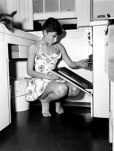 Audrey Hepburn wearing a cool play suit as she does the chores in her New York apartment. 2nd July 1954