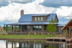 A gorgeous wrap-around porch shelters you from the hot sun and rain in this large Country house plan that is exclusive to Architectural Designs.While the standard ceiling height is 10 Porch House Plans, Lake House Plans, House With Porch, New House Plans, Dream House Plans, Barn Homes Floor Plans, House Floor Plans, Farmhouse Plans, Farmhouse Design