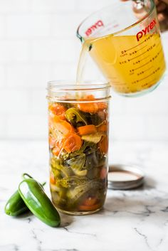 Easy Pickled Jalapenos - Isabel Eats These Pickled Jalapenos are easy to make and are great for topping on all your favorite Mexican foods like nachos, tacos and enchiladas! Pickled Jalapeno Recipe, Pickled Jalapeno Peppers, Pickled Garlic, Pickled Radishes, Pickled Carrots, Jalapeno Recipes, Pickling Jalapenos, Stuffed Jalapeno Peppers, Spicy Carrots