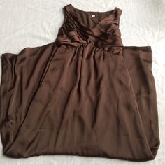 NWT Brown Formal Silky Maxi Dress WITH POCKETS! New with tags. From target but no brand name on dress. Very flattering. Has hidden pockets! Dresses