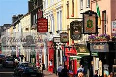 Killarney,Co Kerry,Ireland;Traditional signs hanging from shopfronts - Stock Photos : Masterfile Tourist Center, Irish Eyes Are Smiling, Hanging Signs, Street Signs, Places To Go, Street View, Stock Photos, Traditional, Image