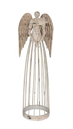 Beautiful vintage inspired garden angel. This metal garden statue has been painted with numerous layers of varying colors and then distressed for that wonderful timeless look. Detailed wings and a star wand accent the top while open lattice work on the bottom allows your plants to peak
