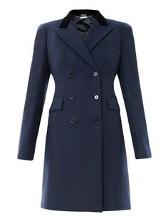 This navy wool coat has a contrasting black velvet collar, peaked lapels, a double-breasted buttoned front fastening and long sleeves with a buttoned cuff detail.