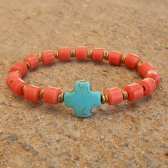 Boho chic, coral vintage glass with African Trade bead and sideway cross bracelet