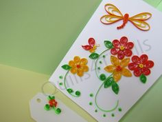 New quilled spring card with flowers, dragonfly, and mini butterfly.  Comes with matching gift tag