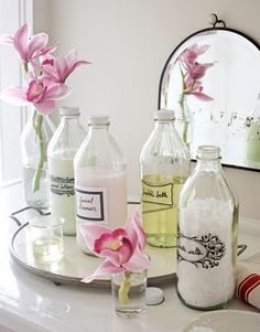 DIY labels on vintage bottles filled with bath salts, oils and of course flowers!