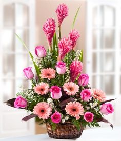 With one dozen pink roses and pink gingers too, this lovely arrangement will leave her speechless with admiration! Set off with foliage and based in a pretty basket, our pink flower basket i Altar Flowers, Church Flowers, Funeral Flowers, Silk Flowers, Wedding Flowers, Flowers For You, Beautiful Flowers, Ikebana, Large Flower Arrangements