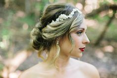 Boho bride wearing a custom headpiece by Jannie Baltzer. Messy bun and makeup by Brock Stacey of Studio B. Photo courtesy of The Love Studio.