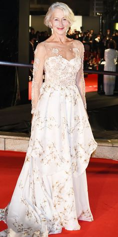 Dame Helen Mirren was royalty at the 2015 Tokyo International Film Festival Opening Ceremony in a sweeping floral-strewn tiered gown with an embroidered sheer yoke.